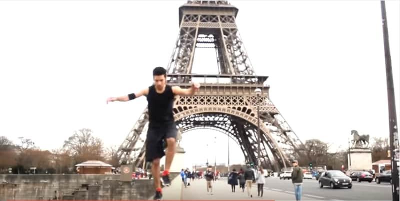 Уличный гимнаст удивляет публику зрелищными трюками. Видео