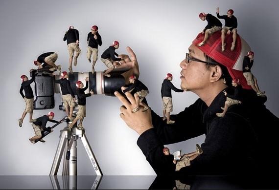 фотограф с камерой