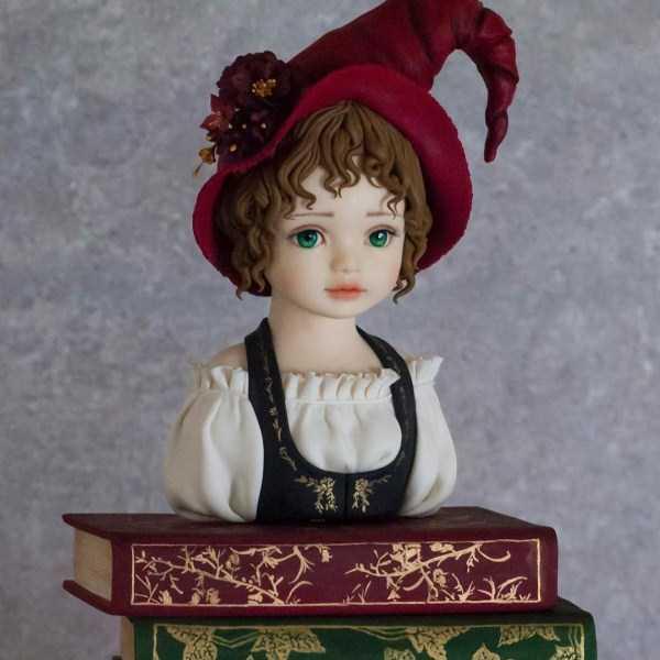торт в форме девочки с книжками