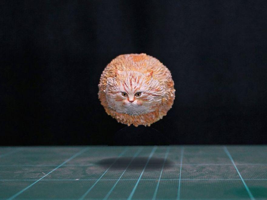 скульптура рыжего кота