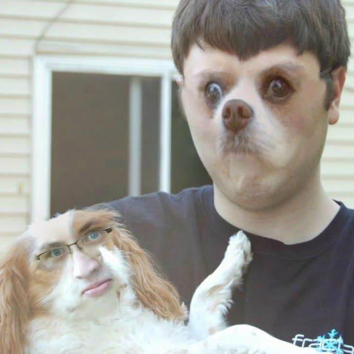 парень держит собаку на руках