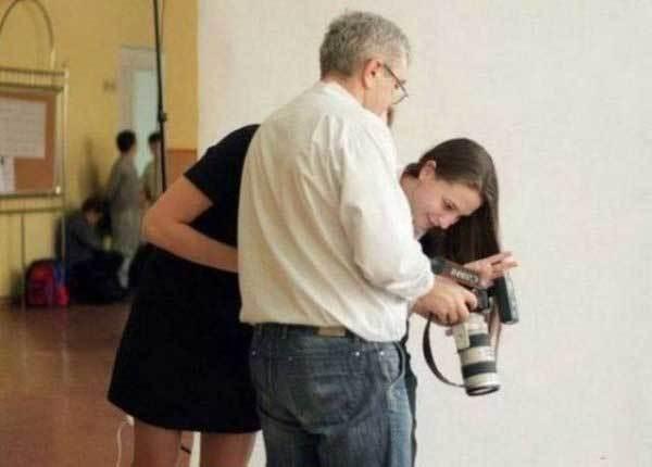 мужчина с фотоаппаратом и девушка