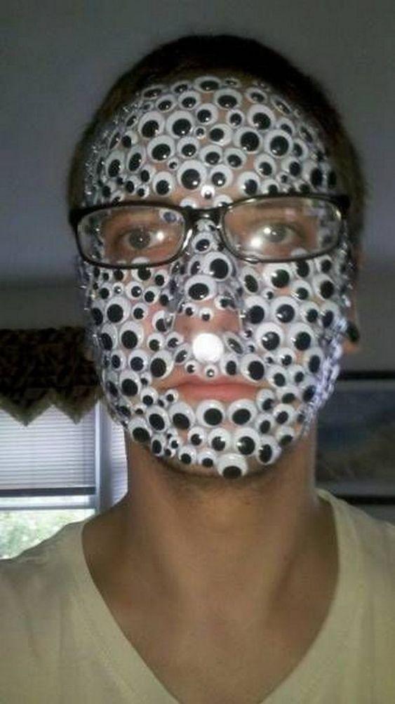 мужчина в очках с наклейками на лице