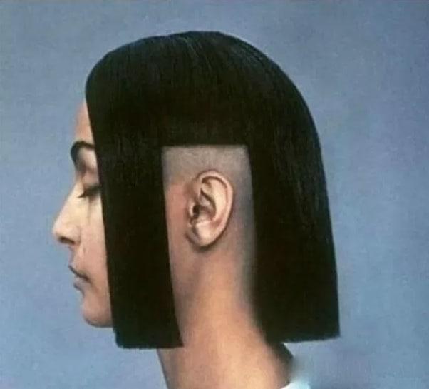 девушка с выбритыми волосами возле уха