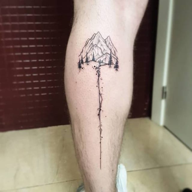 тату на ноге в виде гор