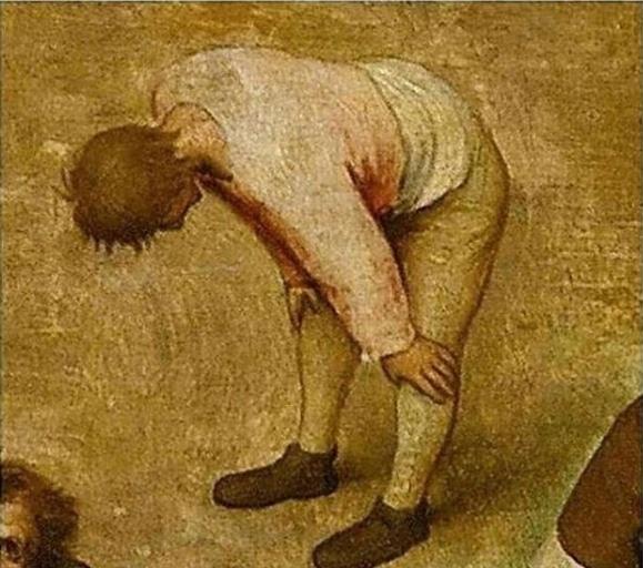 парень облокотился о колени