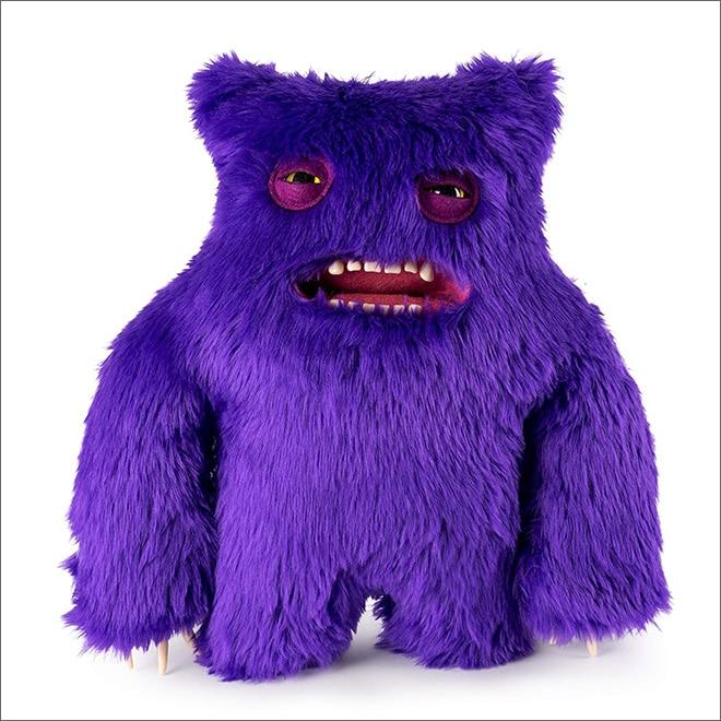фиолетовая игрушка с зубами