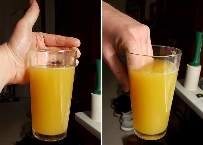 рука в стакане с соком