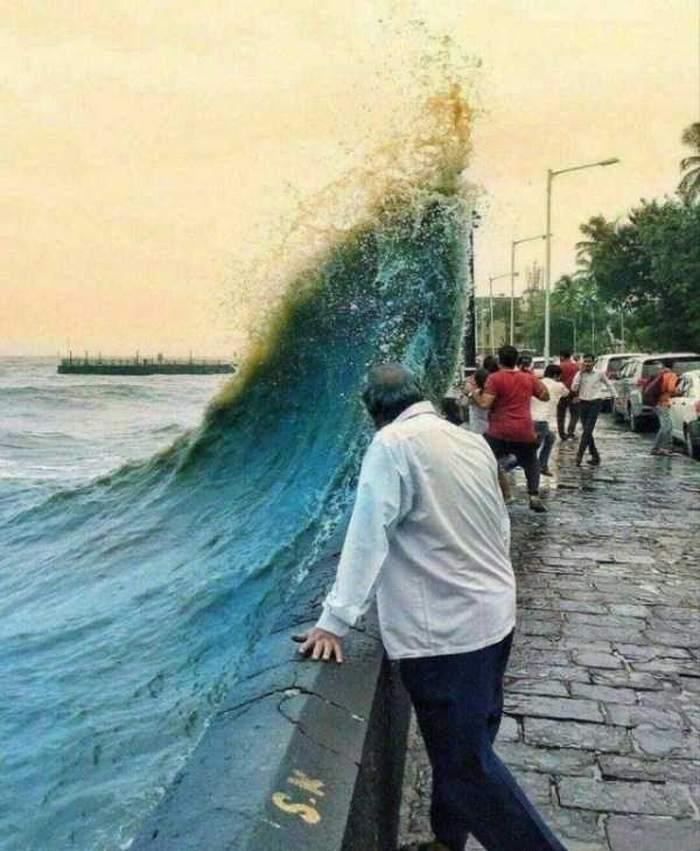 волна накрывает людей