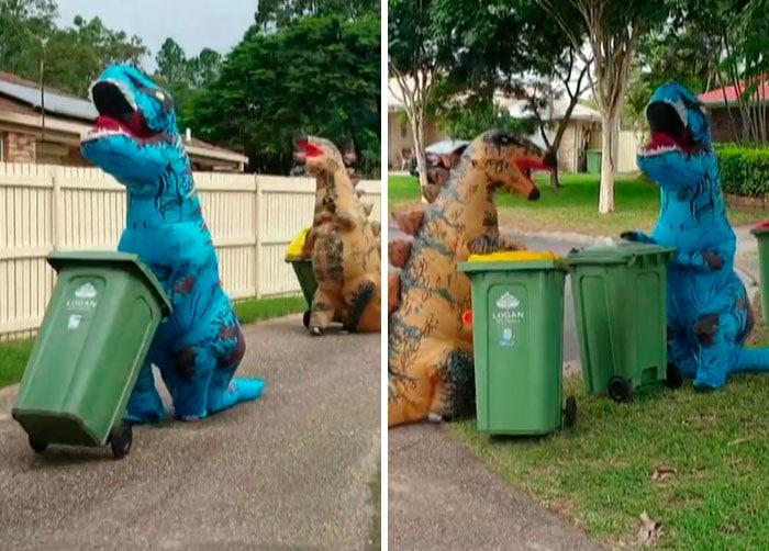 люди в костюмах динозавров выносят мусор