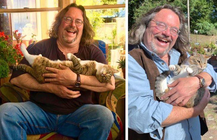 бородатый мужчина в очках с кошкой на руках