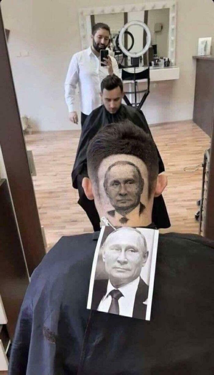 портрет путина на затылке